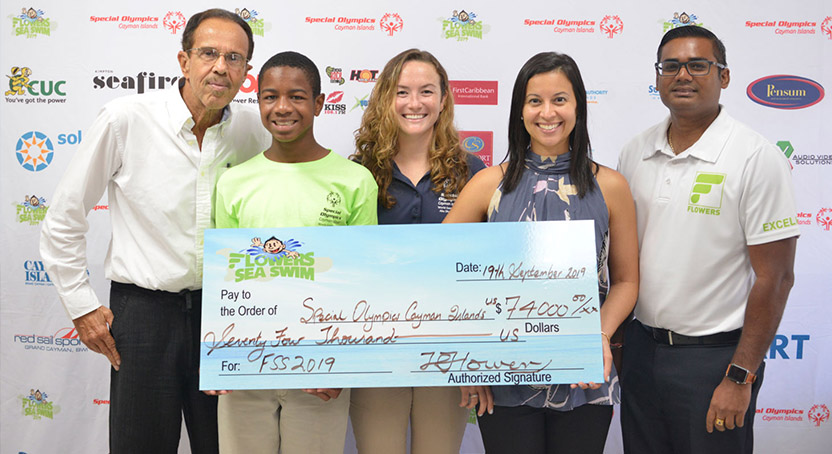Flowers Sea Swim presents cheque to Special Olympics